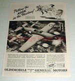 1943 WWII Oldsmobile Mustang Fighter Plane Ad - Kick!
