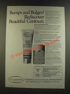 1986 Clarins Contouring Body Cream and Body Treatment Oil Ad