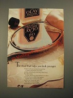 1987 Oil of Olay beauty fluid Ad - Helps You Look Younger
