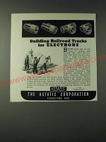 1943 Astatic Corporation Ad - Building railroad tracks for electrons