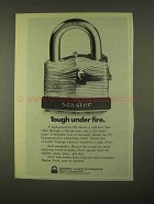 1974 Master Lock Ad - Tough Under Fire