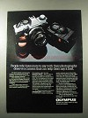1983 Olympus OM-G and XA2 Camera Ad - Deserve