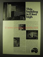1973 Nikon F2 Camera Ad - Building is 2 Feet High