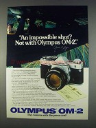 1982 Olympus OM-2 Camera Ad - An Impossible Shot?