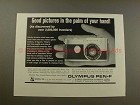 1966 Olympus Pen F Camera Ad - Pictures in Palm of Hand